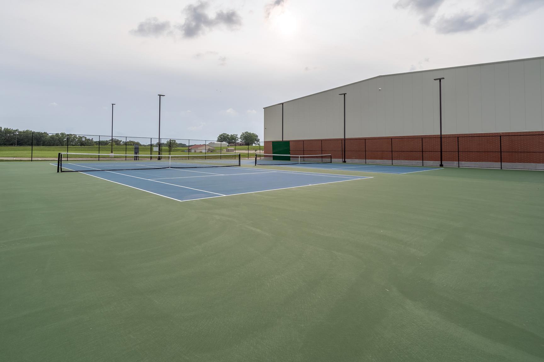 <p>Tennis <p>Courts